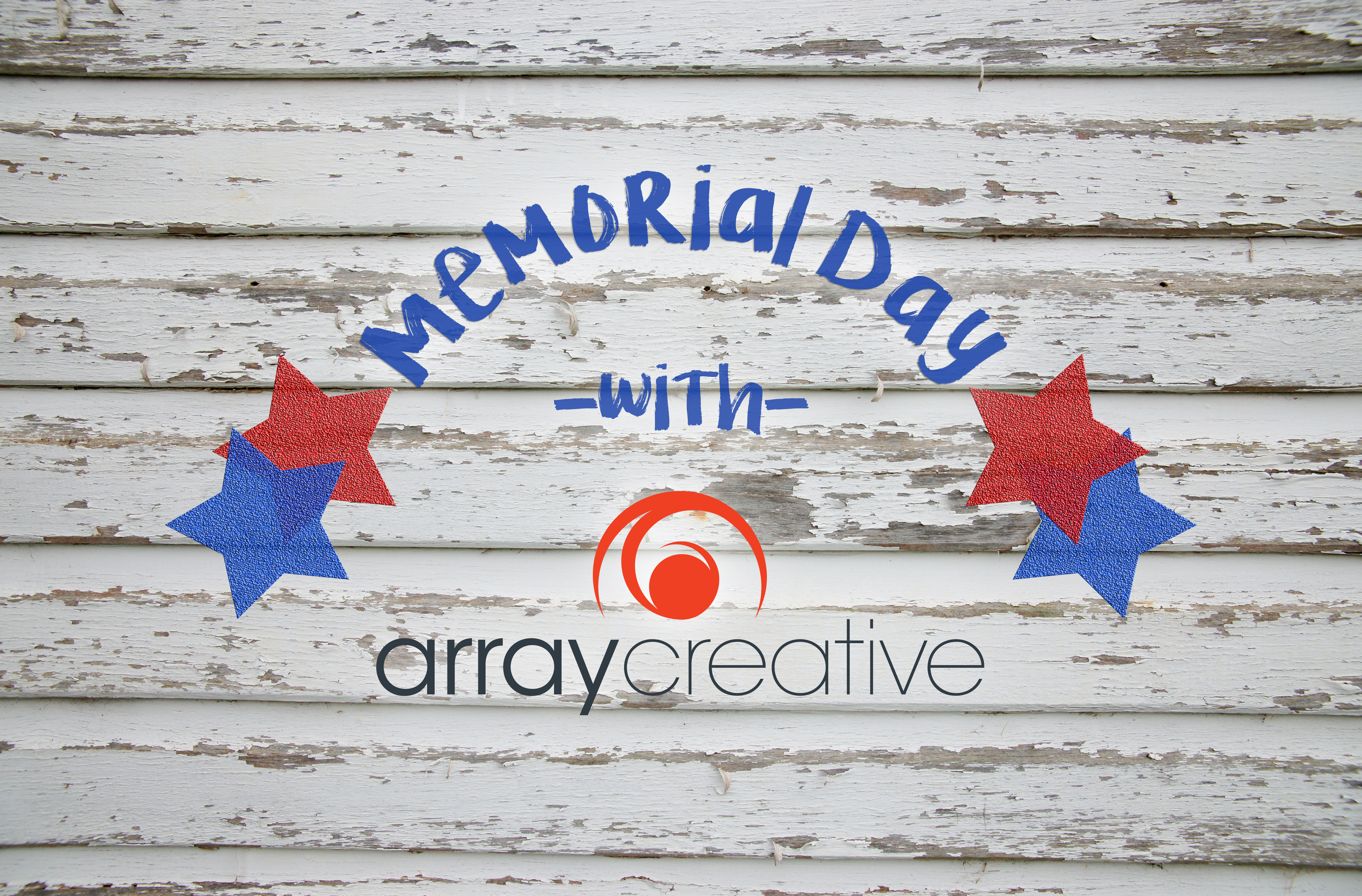 Memorial Day with Array Creative on a white wooden background with red and blue stars